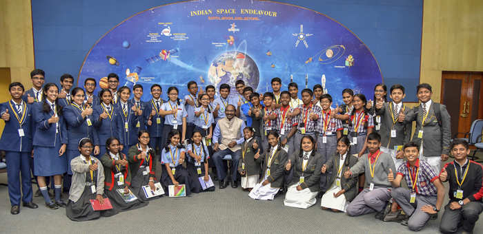 Chairman ISRO, Space Commission and Secretary, Department of Space, Dr. K. Sivan in a group photograph with the students during the 'Samwad with Students' (SwS), part of the enhanced outreach programme of ISRO, in Bengaluru on January 01, 2019