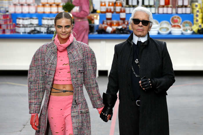 Supermodel Cara Delevingne​ and ​Karl Lagerfeld​ (R)