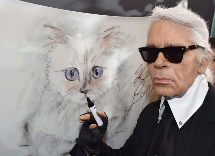 Karl Lagerfeld with a picture of his cat Choupette
