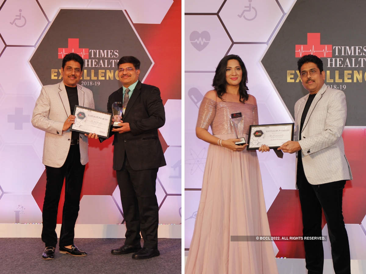 Shailesh Lodha presented The Times Excellence in Service in Oncology surgeon to Dr Anil Heroor, and Dr Monica Jacob in health & wellness.