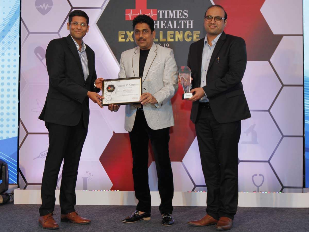 Shailesh Lodha (C) presented The Times Health Excellence In Service In Healthcare delivery to Dr Ashish Joshi (L) and Dr Vashistha Maniar (R), Founders, MOC Group.
