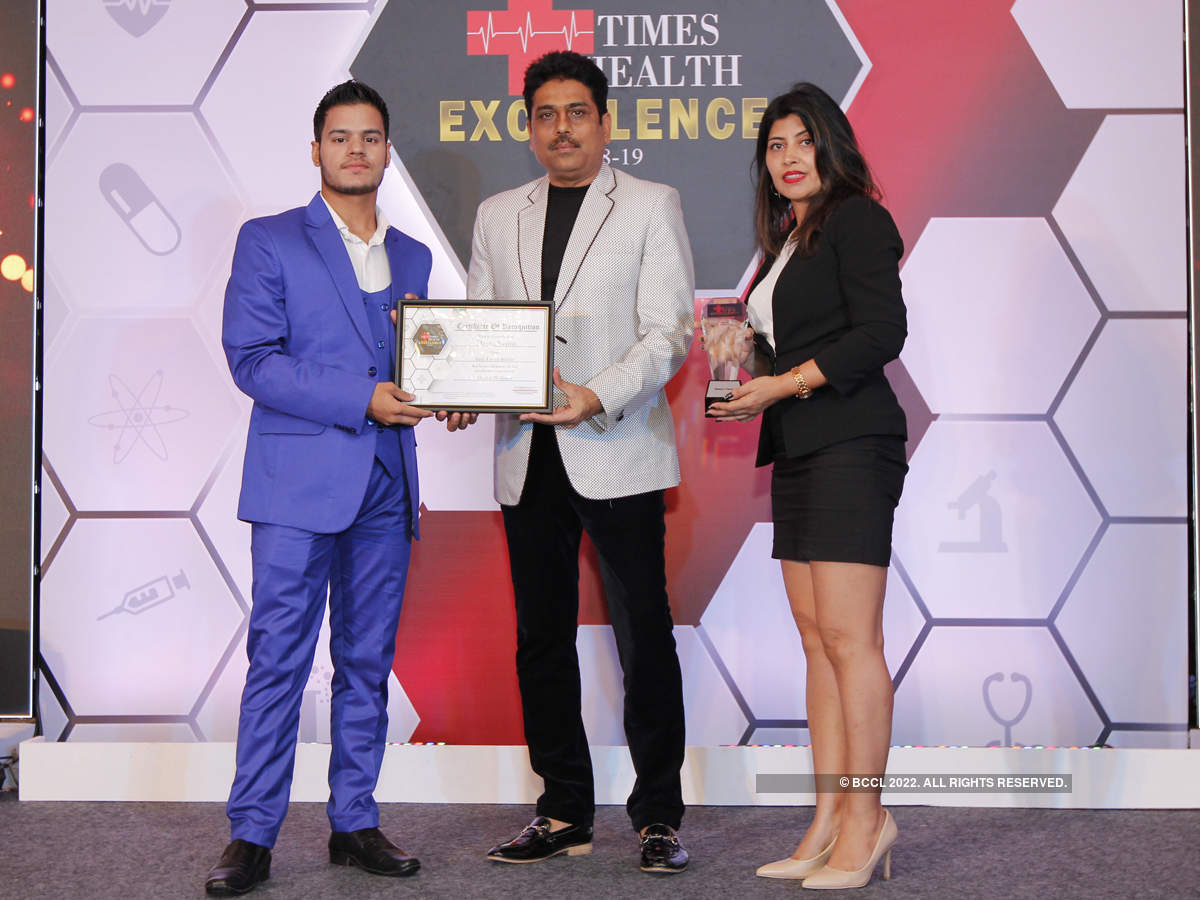 Shailesh Lodha presented The Times Health Excellence In Service In Mental Wellness to Aadi's Tantra Studio (L-R) Akash Gupta, General Manager and Meenu Verma, Chairman