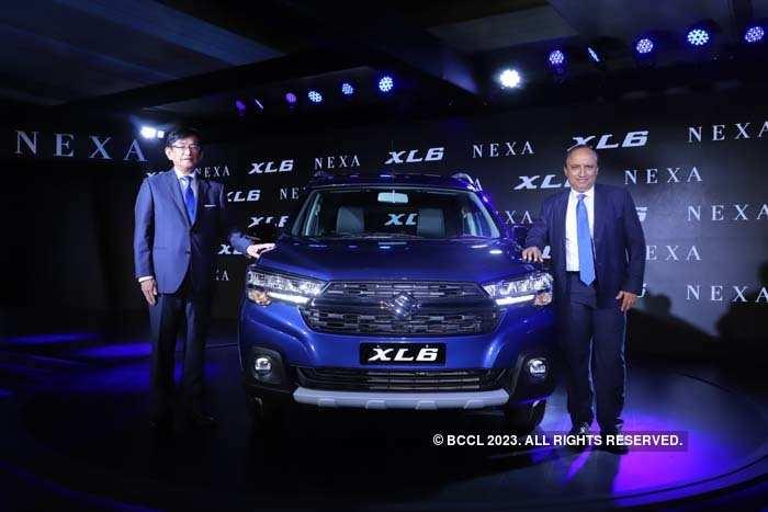 Kenichi Ayukawa (L) and Shashank Srivastava, Executive Director (Marketing & Sales) of Maruti Suzuki India, launch the new premium XL6.