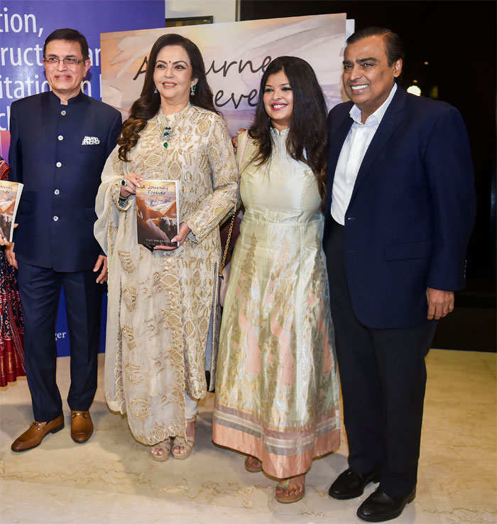 Mukesh Ambani (R) and wife Nita (second left) at the book launch of Dr Vijay Haribhakti's (left) 'A Journey Forever'.