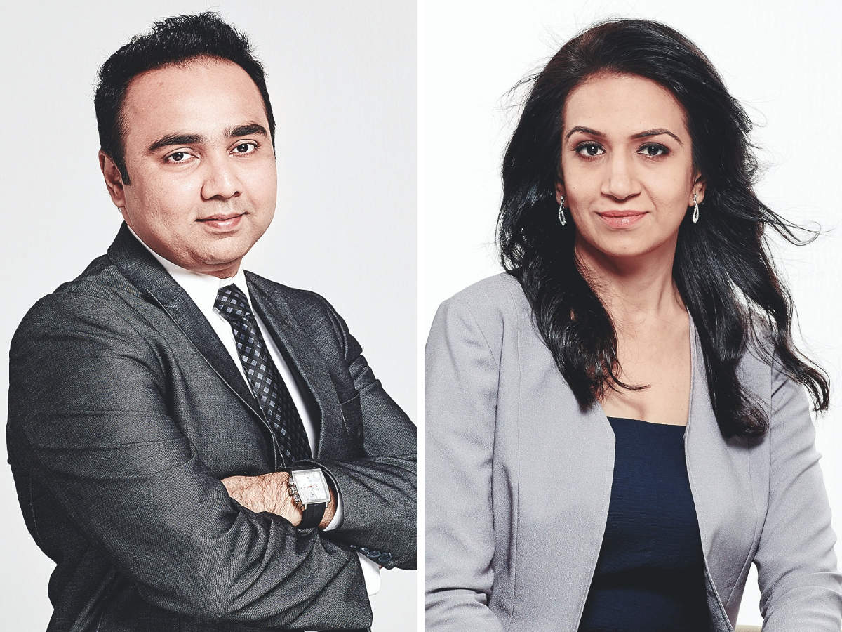 Vishal B Malkan (L) coached his wife Meghana (R) about the highs and lows of the stock market.
