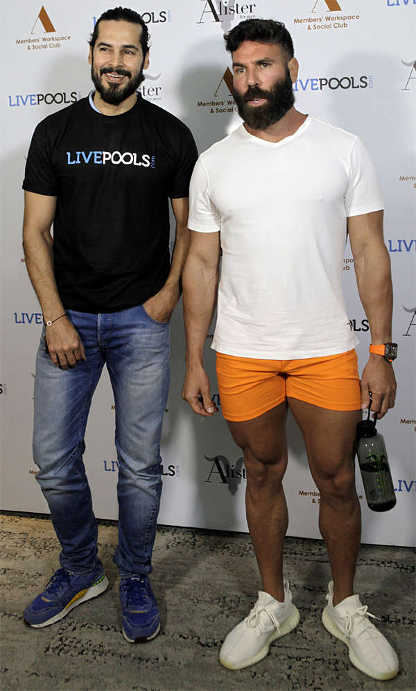 Dan Bilzerian poses with Dino Morea at an event to announce his association with sports predictor platform LivePools, in Mumbai.
