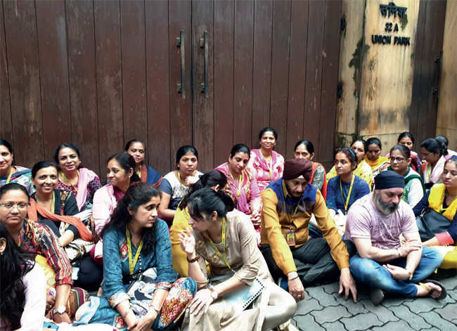 Employees of PMC Bank stage a silent protest outside the Bandra residence of HDIL vice-chairman Sarang Wadhawan