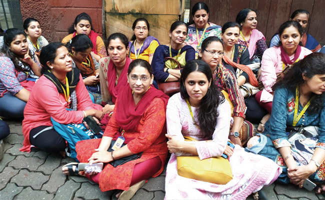 Punjab and Maharashtra Cooperative Bank employees and customers protest outside HDIL's office in Bandra yesterday