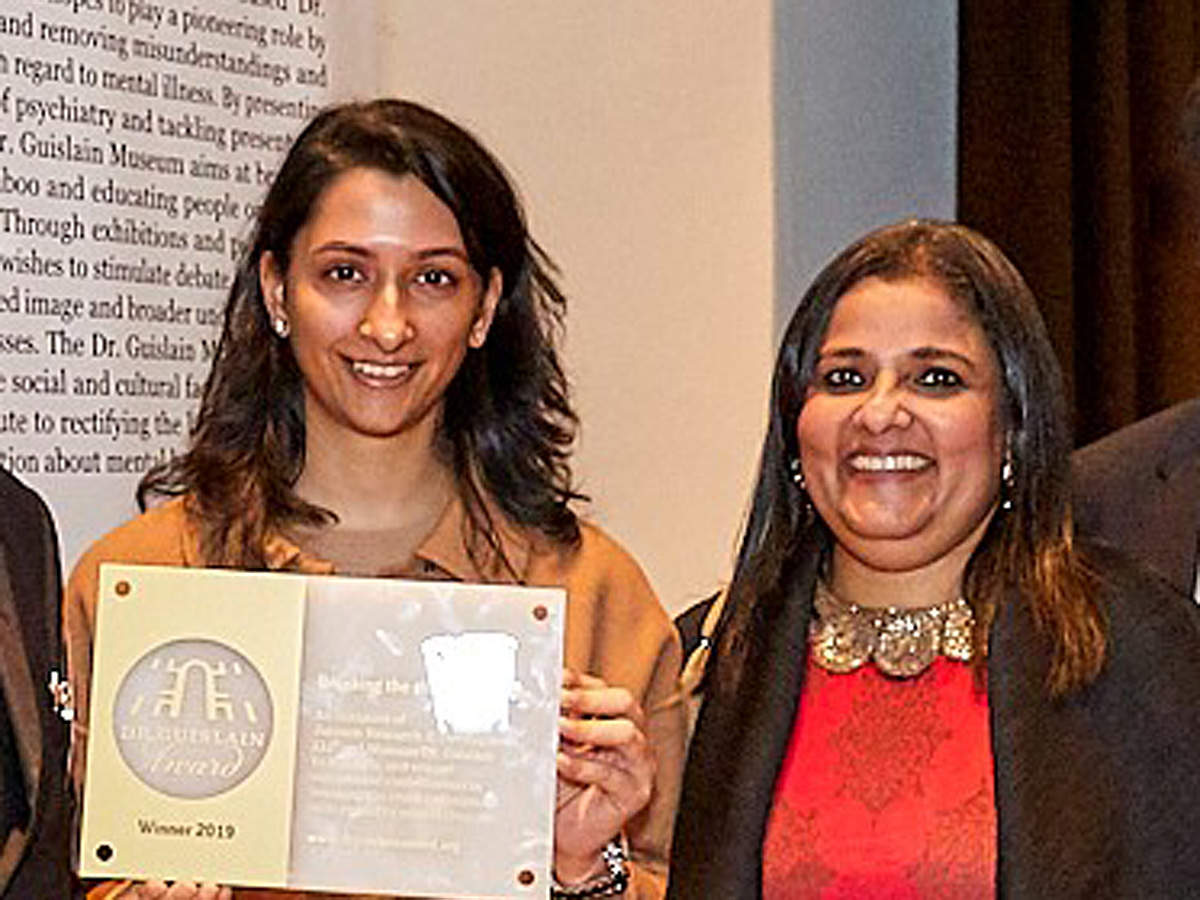 Deepika Padukone's sister​ and ​professional golf player​ Anisha Padukone​ and Anna Chandy​, Chaiperson of TLLLF, pose with Dr Guislain 'Breaking the Chains of Stigma' Award​.