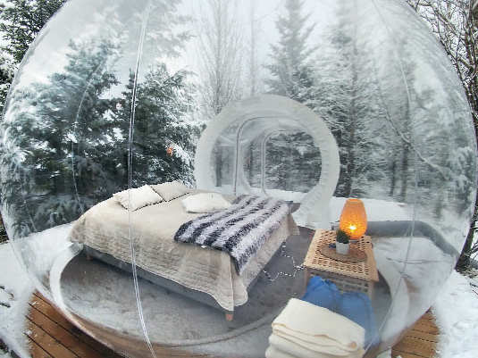 In Iceland, transparent chambers mimicking bubbles allow a glimpse of the Northern Lights while in bed.