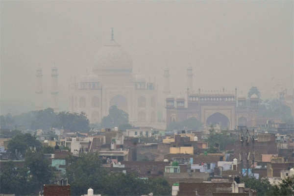 ​A view of Agra with the Taj Mahal shrouded in smog.