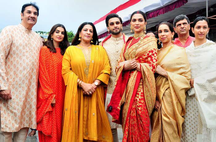 (L-R) Jagjit Singh Bhavnani, Ritika Bhavnani, Anju Bhavnani, Ranveer Singh, Deepika Padukone, Ujjala Padukone, Prakash Padukone and Anisha Padukone all smiles at the Tirupati Temple.