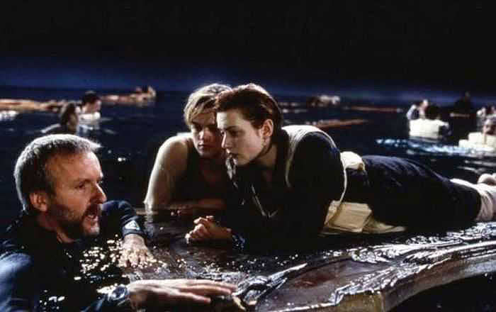 Director James Cameron (L) briefing Leonardo DiCaprio (C) and Kate Winslet (R) during the shooting of 1997 classic 'Titanic'.