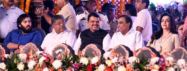 L-R: Anant Ambani, BJP state president Chandrakant Patil, former Maharashtra CM Devendra Fadnavis, Reliance Industries chairman Mukesh Ambani and wife Nita Ambani attend the swearing-in ceremony of Uddhav Thackeray at Shivaji Park.