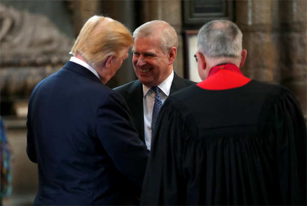 ​Prince Andrew smiles and shakes hands with US President Donald Trump during the latter's visit to Westminster Abbey in London, England.​