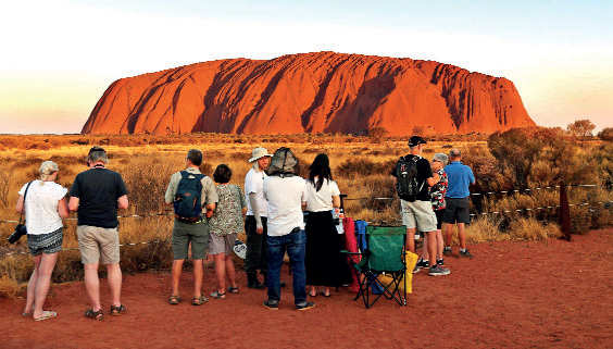 ​Sunset view of Ayer's Rock or Uluru in Australia is vastly popular. The Uluru-Kata Tjuta National Park board is unanimously upholding its decision to ban all touristy climbing activities on this sacred UNESCO site since Oct, 2019​.