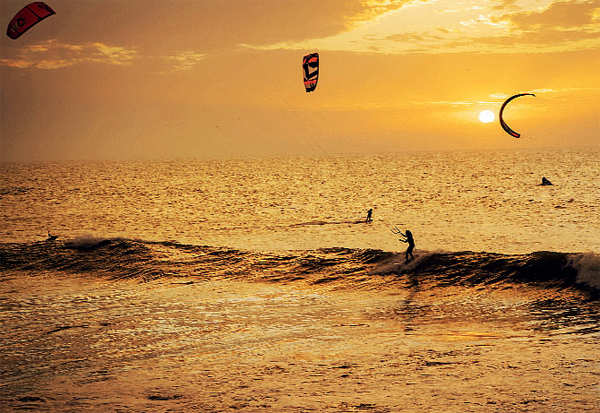 ​Kitesurfers ride the waves at sunset at Dakhla Beach in Morocco-administered Western Sahara​.