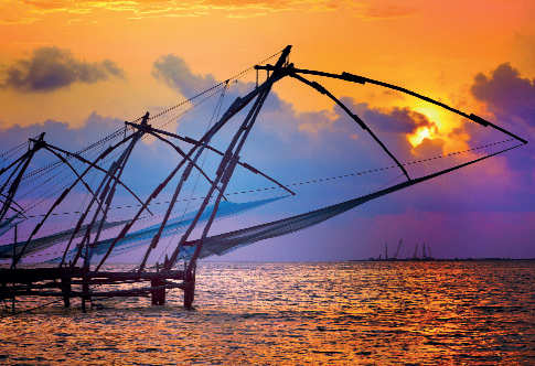 ​Fort Kochi offers a glimpse of the sun peering through the Chinese fish nets across the coast.​