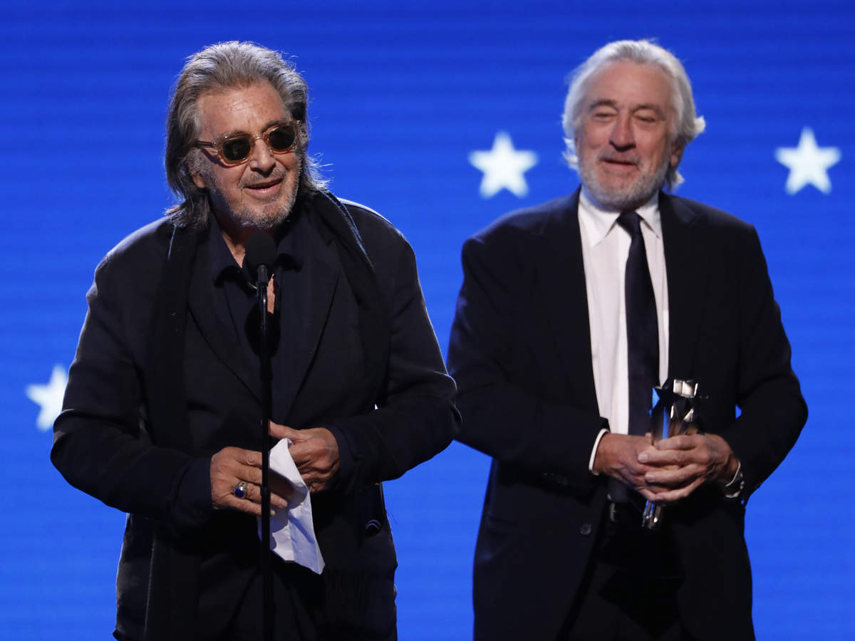 Robert De Niro (R) expressed surprise as he and Al Pacino collected the best acting ensemble prize for 'The Irishman'.