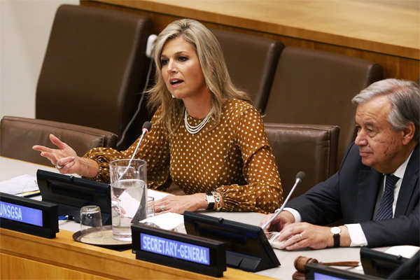 Queen Maxima of the Netherlands, sitting beside United Nations Secretary-General Antonio Guterres, delivers remarks at a side event regarding financial inclusion for development during the 74th session of the U.N. General Assembly, at the U.N. headquarters.