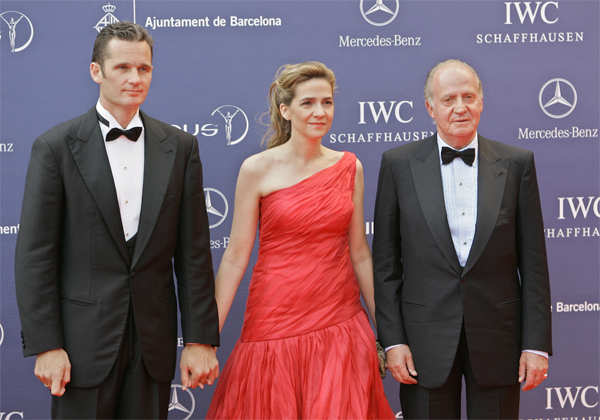 2006 file photo: Spain's King Juan Carlos, right, arrives with his daughter, Princess Cristina and her husband Inaki Urdangarin for the Laureus World Sports Awards in Barcelona, Spain.