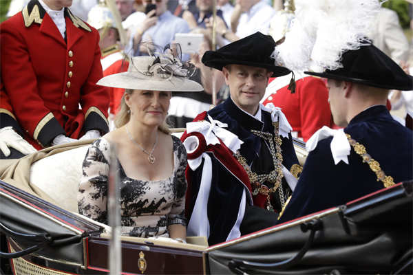 2018 file photo: Britain's Prince Edward, center, and his wife Sophie, Countess of Wessex, leave in a carriage after the Order of The Garter Service at Windsor Castle in Windsor, England. 