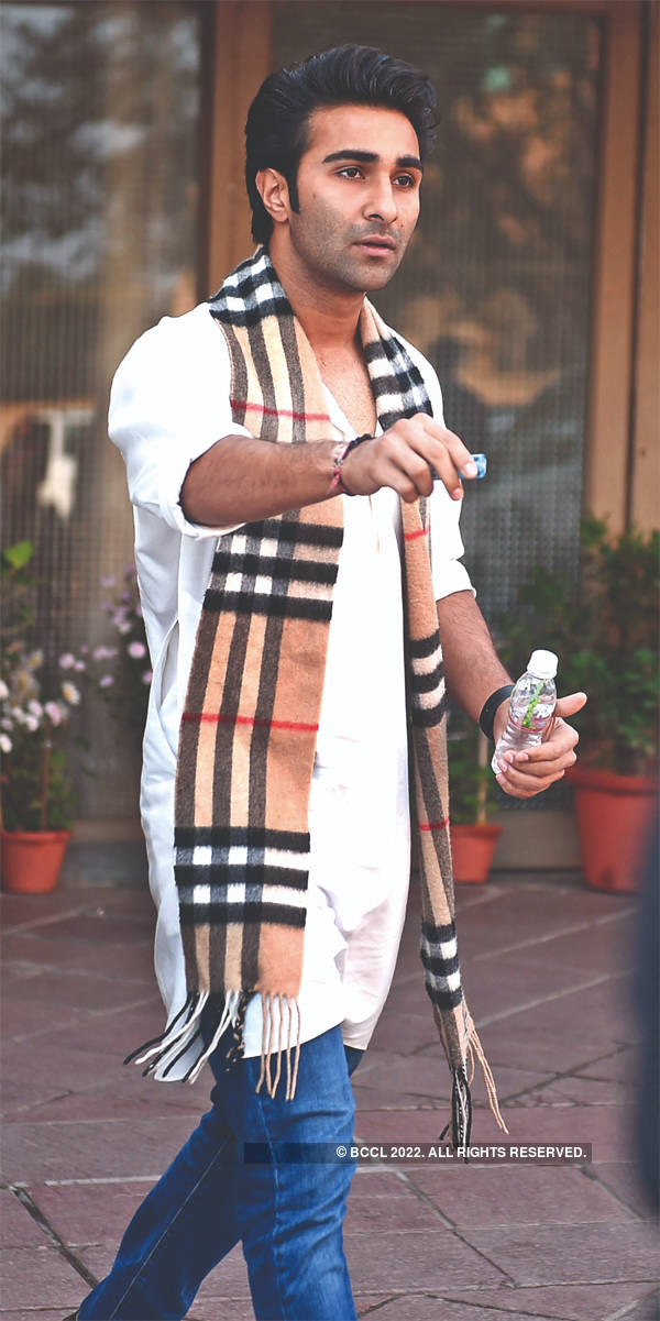 Aadar Jain was spotted in a Burberry muffler over a white kurta at the prayer meet.