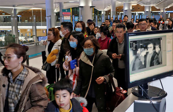 Passengers from China pass by a thermal screening point upon their arrival at Istanbul International Airport in Turkey.
