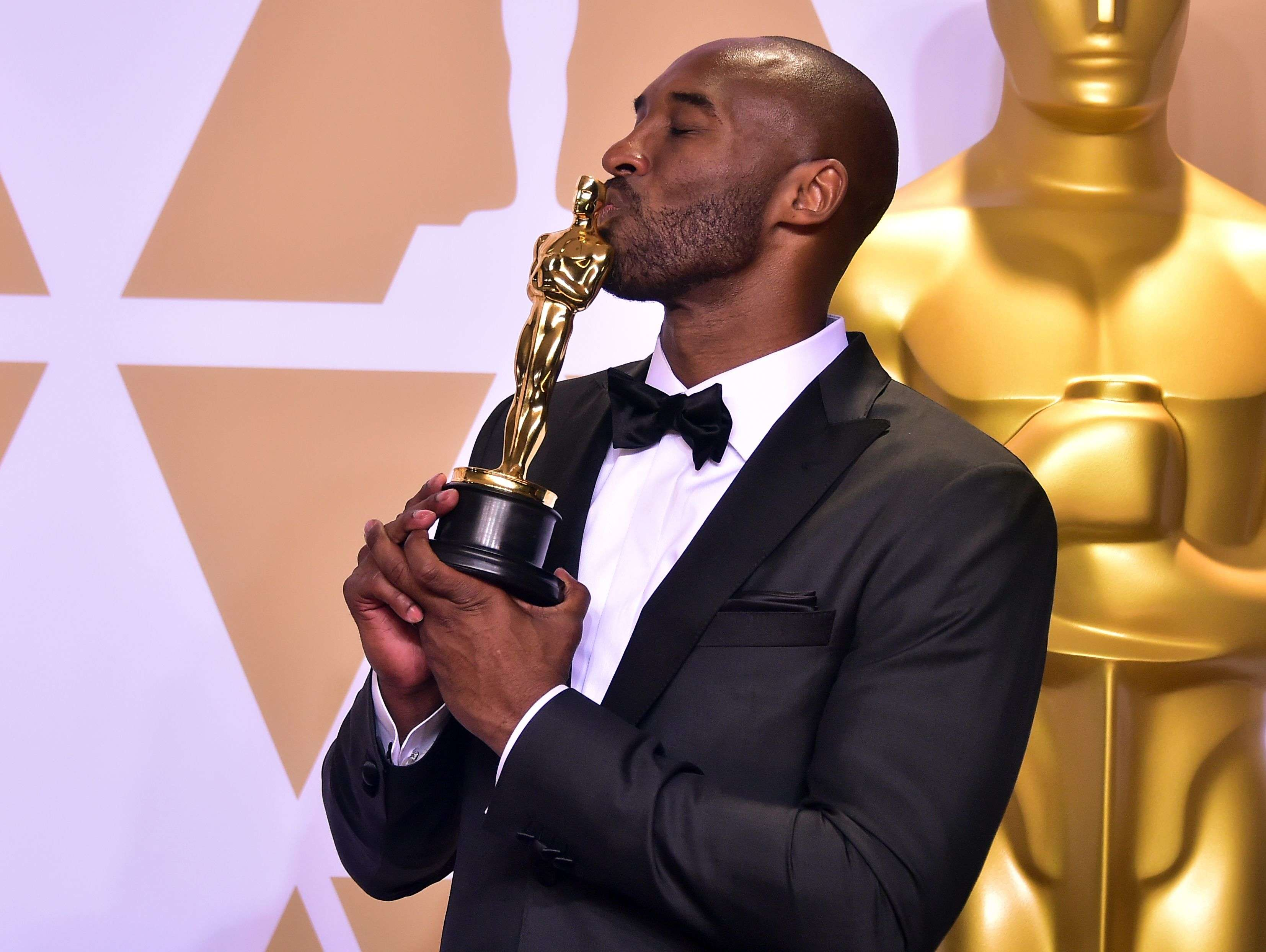 Kobe Bryant poses with the Oscar that he won for his movie 'Dear Basketball' in the Best Animated Short Film category in 2018 during the 90th Annual Academy Awards in Hollywood, California.