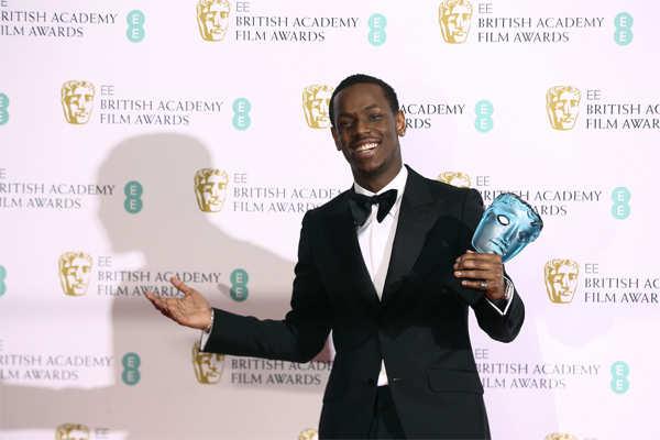 Micheal Ward poses with his Rising star award.