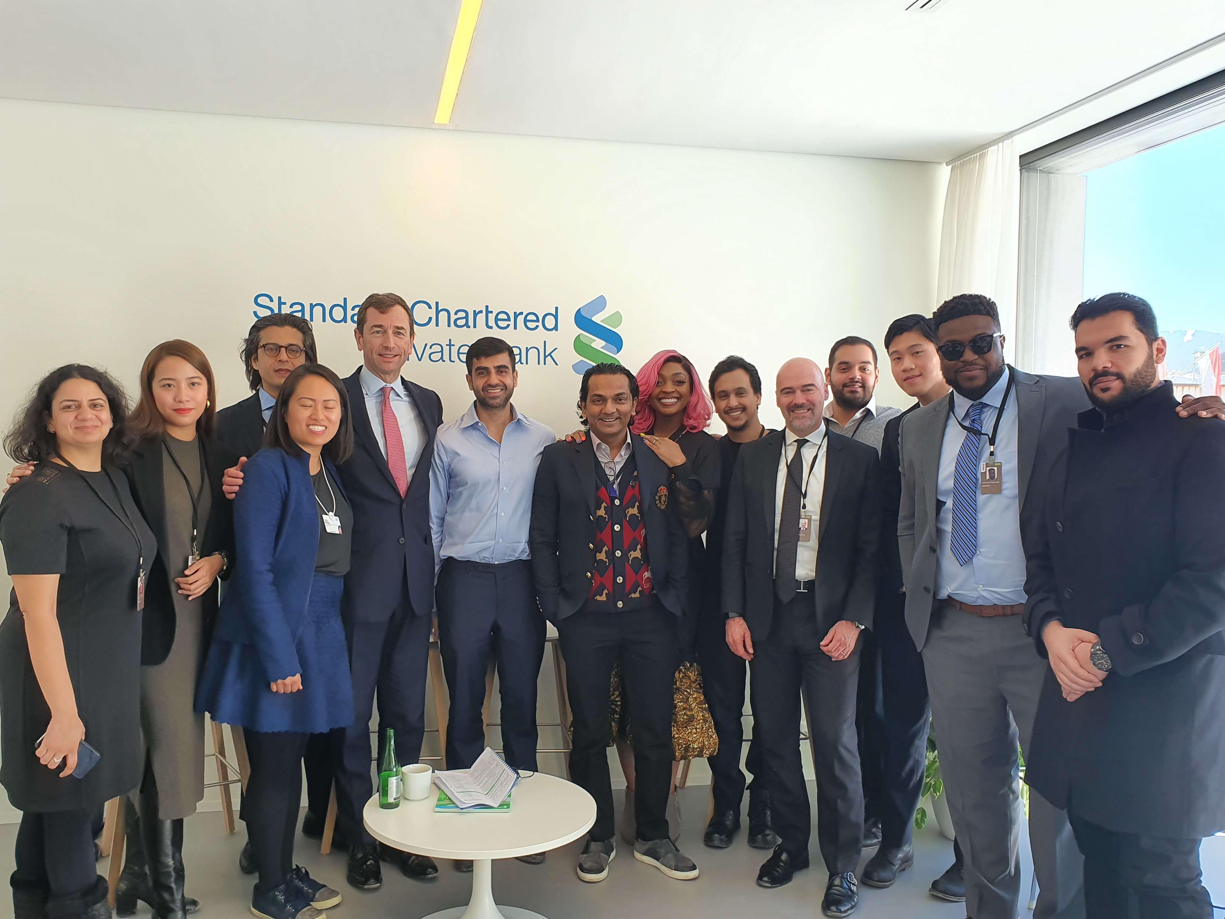 Nikhil Kamath (centre) with Divyank Turakhia and guests at Davos.
