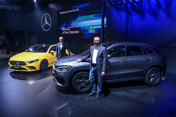 ​Managing Director and CEO of Mercedes-Benz India, Martin Schwenk (R), and and Mercedes-Benz Cars, Head Region Overseas, Matthias Luehrs, (L), ​ pose with the Mercedes GLA car and the Mercedes A-Class Limousine at the Auto Expo 2020 at Greater Noida.