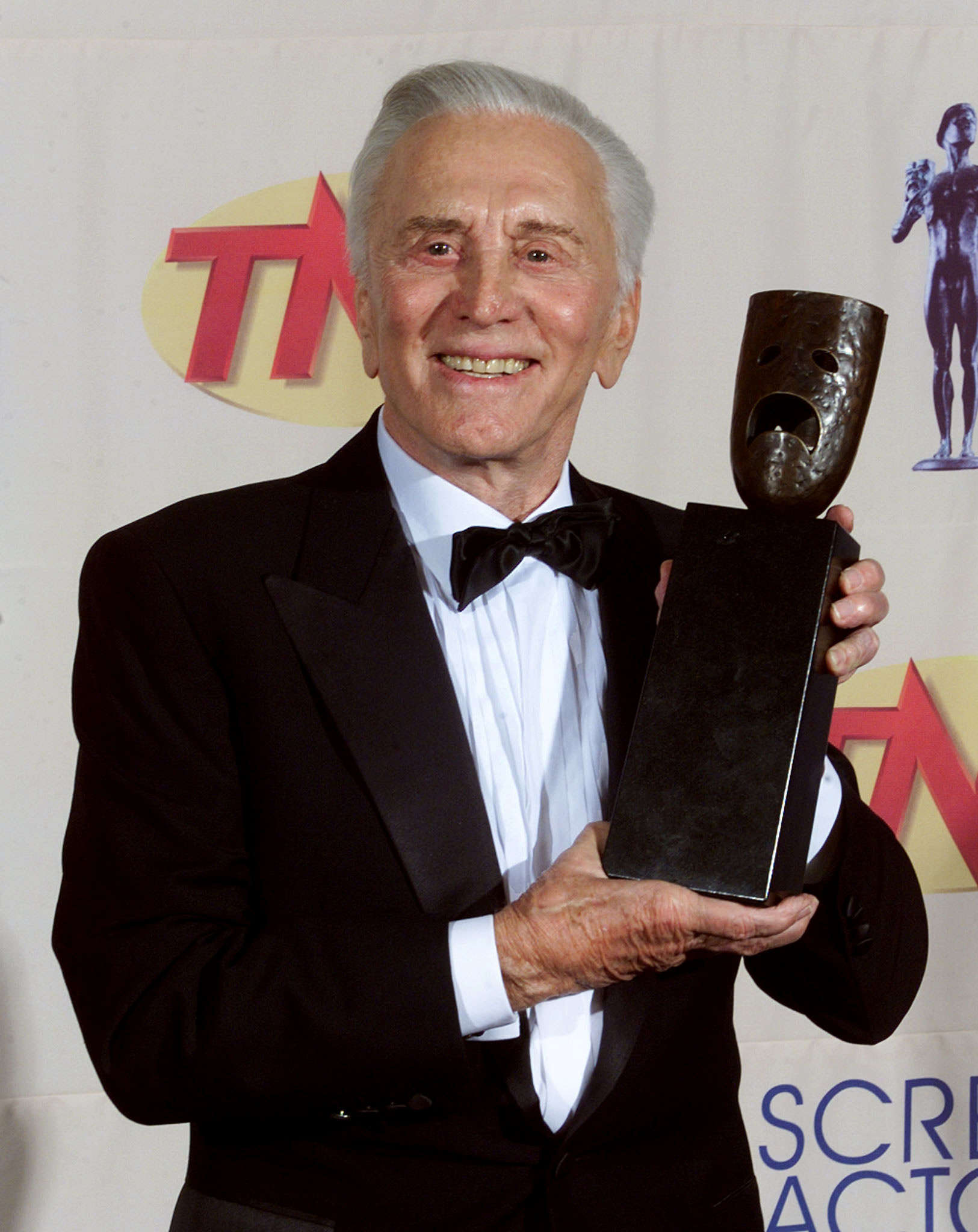 Kirk Douglas with his Screen Actors Guild Life Achievement Award which was presented to him at the 5th Annual Screen Actors Guild Awards in Los Angeles in March 1999.