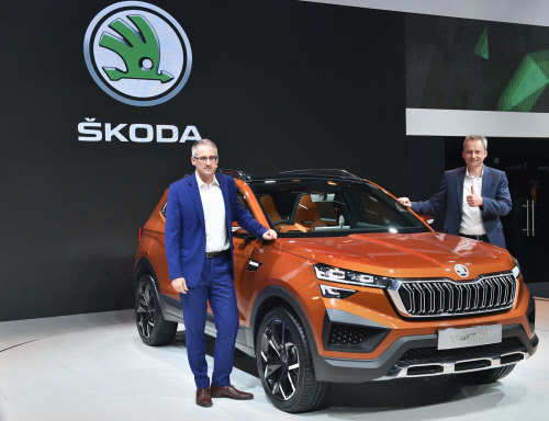 Head- Sales & Marketing, Skoda India Zac Hollis (L) with newly launched Skoda Vision IN, during the Auto Expo 2020.