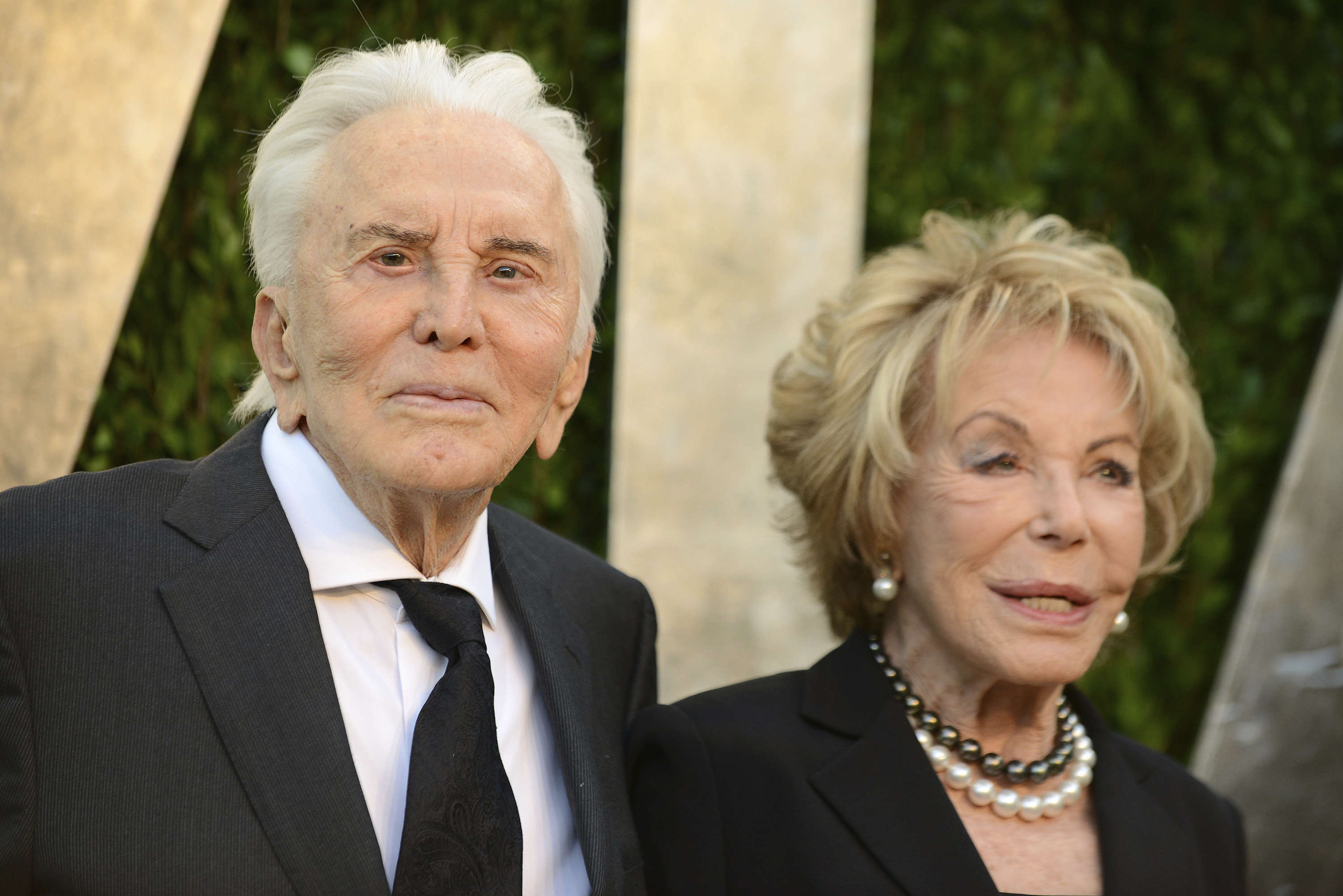 FILE PHOTO: Kirk Douglas (L) and his wife Anne attended the 2013 Vanity Fair Oscars Party in West Hollywood.