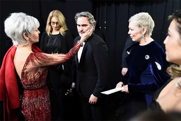 ​Jane Fonda consoles Joaquin Phoenix, who got teary eyed while mentioning his late brother during his acceptance speech after winning the Best Actor Academy Award.