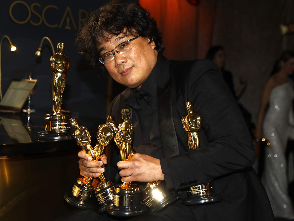 Bong Joon Ho (in pic) poses with the Oscars for 'Parasite' at the Governors Ball following the 92nd Academy Awards in Los Angeles, California
