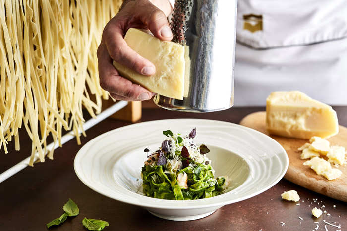 Chef in action  at the Capri Court Italian Restaurant at Shangri-La's Barr Al Jissah Resort & Spa.