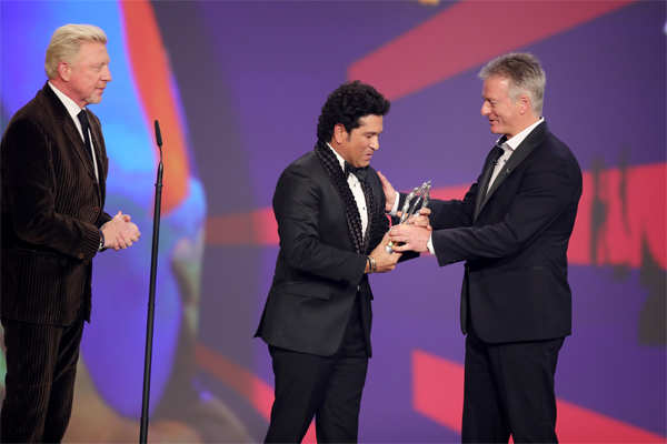 ​Laureus Academy members Boris Becker (L) and Steve Waugh (R) present the Laureus Best Sporting Moment trophy to Sachin Tendulkar during the 2020 Laureus World Sports Awards at Verti Music Hall in Berlin, Germany.
