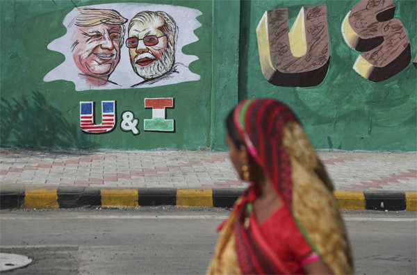 Portraits of Donald Trump and Narendra Modi painted on wall in Ahmedabad, ahead of Trump's visit​. To welcome the American President, the Gujarat government has spent almost $14 million on ads blanketing the city that show the two leaders holding up their hands, flanked by the Indian and U.S. flags.