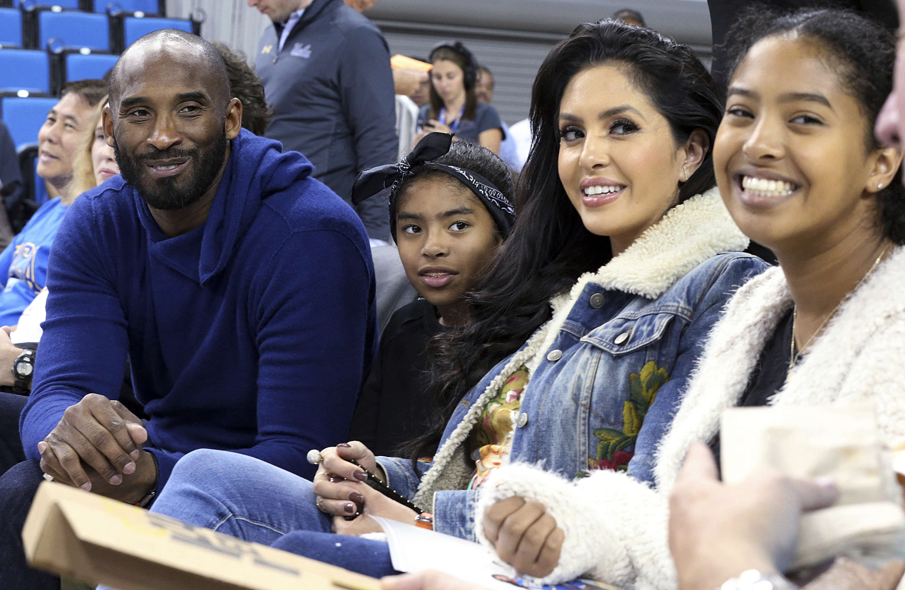 2017 file photo, from left: Kobe Bryant, his daughter Gianna Maria-Onore Bryant, wife Vanessa and daughter Natalia Diamante Bryant pose before a Connecticut-UCLA NCAA women's basketball game in Los Angeles.