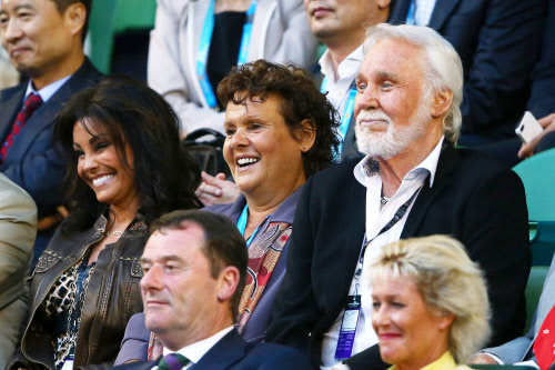 Kenny Rogers and Evonne Goolagong Cawley watch the action at Rod Laver Arena during day 11 of the 2015 Australian Open at Melbourne Park.