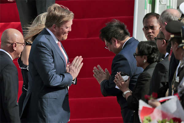 (File image: March 9, 2020) Practising social-distancing,​ King Willem-Alexander of the Netherlands, center left, greets the Indonesian Foreign Minister Retno Marsudi, center right front, and Coordinating Minister for Economic Affairs Airlangga Hartarto, rear center right, with a namaste.