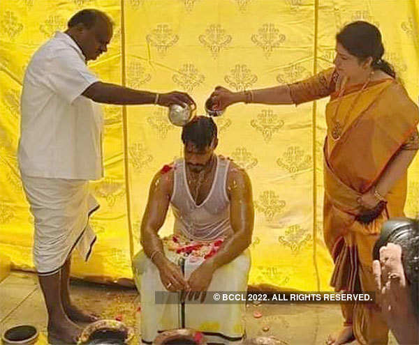 Former Karnataka chief minister H D Kumaraswamy and wife Anitha perform pre-marriage rituals of their son at a farmhouse in Bidadi.