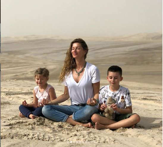 To celebrate Earth Day on April 22, supermodel Gisele Bundchen shared this photo of her doing meditation with her kids Benjamin (10) and Vivian (7)
