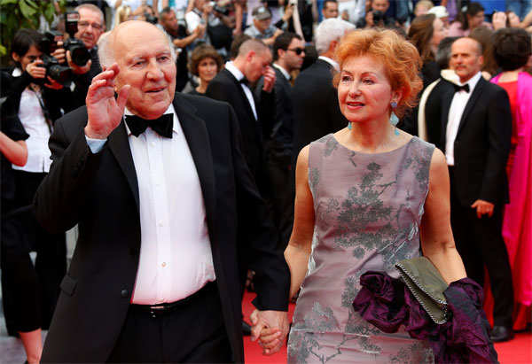 Michel Piccoli (L) and his wife Ludivine Clerc pose on the red carpet as they arrive for the screening of the film 'Saint Laurent' in competition at the 67th Cannes Film Festival in Cannes, France, on May 17, 2014.