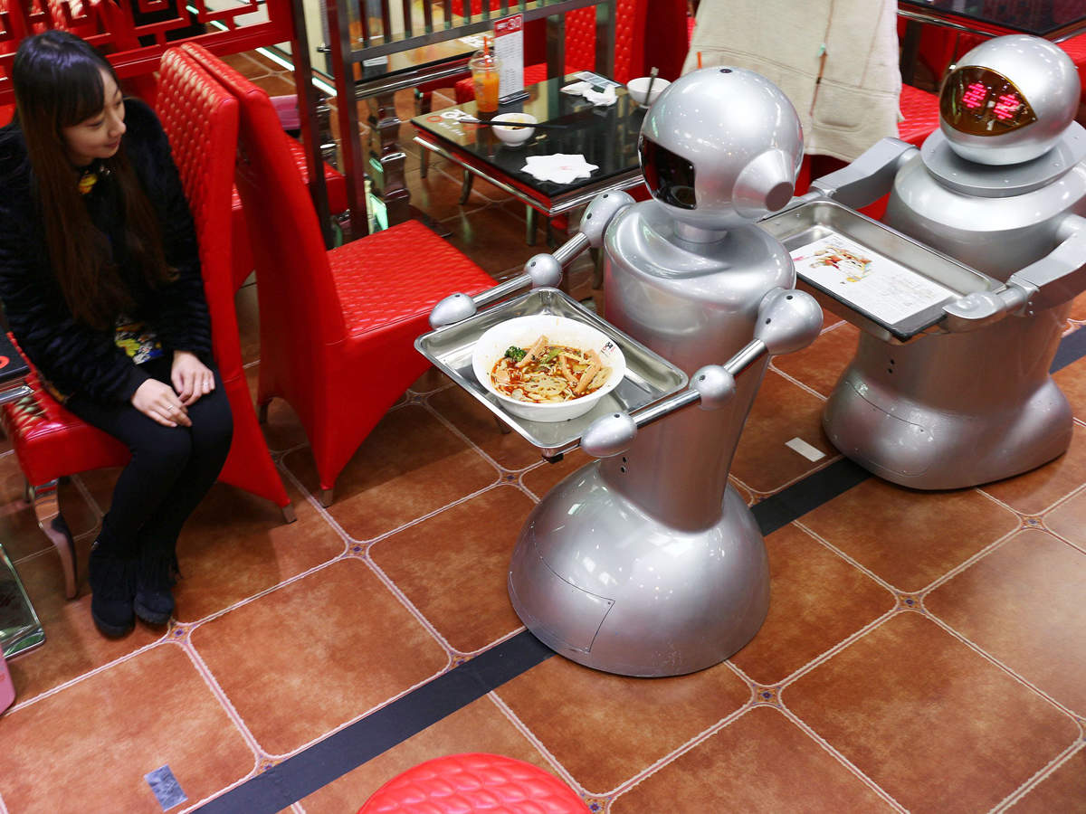 File photo of December 2014: A 70 thousand RMB (about $11,310) robot carries dishes and offers service for customers at a robot themed restaurant at Chunxi Road in Chengdu, China.