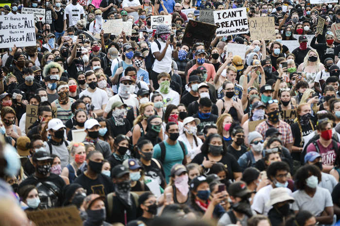 People crowd in front of the Colorado State Capitol to protest on June 1, 2020 in Denver, Colorado.