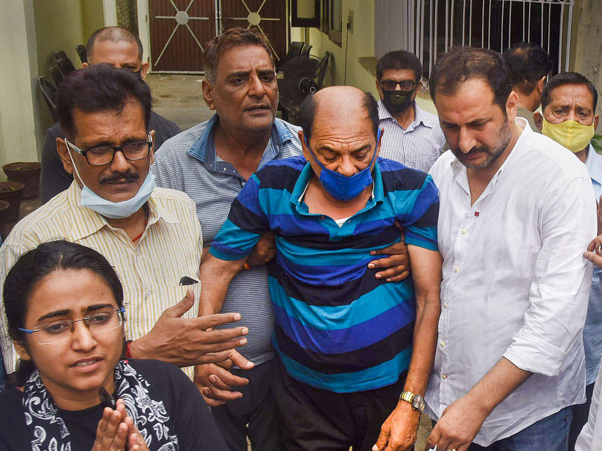 Sushant Singh Rajput's father Krishna Kumar Singh (C) and relative MLA Niraj Kumar Babloo (second R) leave from Patna for Mumbai to perform the actor's last rites.