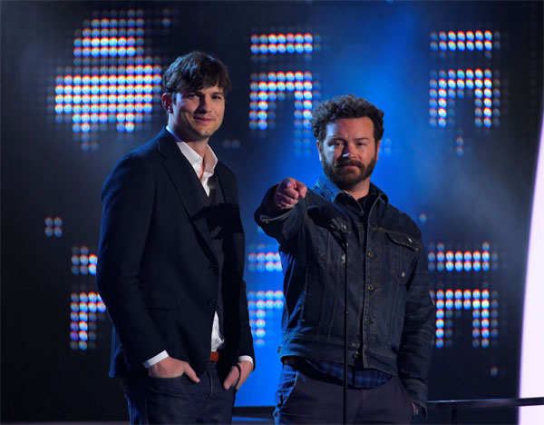 Actors Ashton Kutcher (L) and Danny Masterson present the Collaborative Video of the Year award at the 2017 CMT Music Awards.
